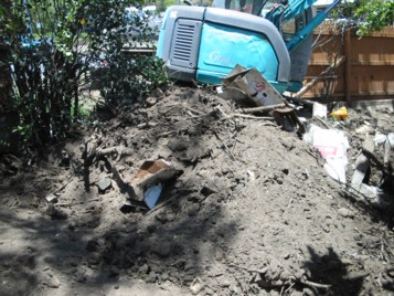 Excavator and heap of soil